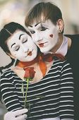 stock photo of clown rose  - dreaming couple of  mime with red rose - JPG
