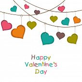 Happy Valentines Day celebration greeting card with hanging colorful hearts on abstract white background.