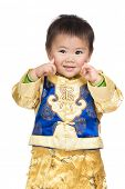Baby boy smile with traditional chinese costume