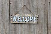 Wood welcome sign on wooden door