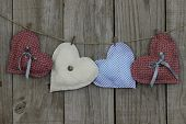 Country hearts hanging on clothesline with wood background