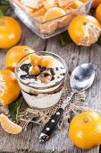 Portion Of Yogurt With Tangerines And Chocolate