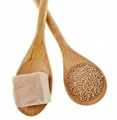 baking ingredient yeast powder in wooden spoon isolated on white background
