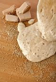 Rising Yeast Dough in bowl on wooden table background