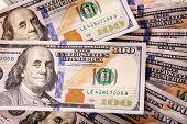 Cash Spread Of New Hundred-dollar Bills