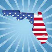 Florida map flag on blue sunburst illustration