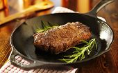 strip steak in iron skillet panoramic photo