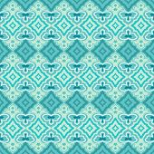 Seamless teal and green abstract geometric vector wallpaper.