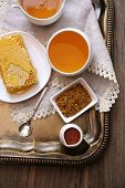 Fresh honey snack on tray on wooden table