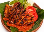 image of ayam  - Grilled chicken with traditional spicy sauce known as Ayam Bakar Penyet - JPG