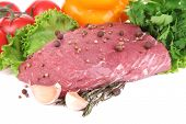 Raw beef meat with vegetables and spices isolated on white