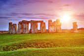 picture of stonehenge  - Fantasy sunrise at Stonehenge with dramatic sky and sun rays - JPG