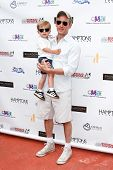 BRIDGEHAMPTON, NY-JUL 19: Actor Dan Abrams (R) and son Everett attend the 6th Annual Family Fair at