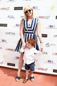 BRIDGEHAMPTON, NY-JUL 19: Actress Jane Krakowski and son Bennett attend the 6th Annual Family Fair a