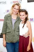 BRIDGEHAMPTON, NY-JUL 19: Ali Wentworth (L) and daughter Elliott Stephanopoulos attend the Annual Family Fair at Children's Museum of the East End (CMEE) on July 19, 2014 in Bridgehampton, New York.