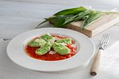 Gnocchi With Wild Garlic In Tomato Sauce And Parmesan Cheese