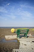 Bench at the german wadden sea, mud covered text saying