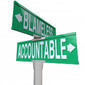 Accountable and Blameless words on two green road or street signs at an intersection showing the cho