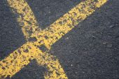 picture of letter x  - Painted yellow lines on asphalt in the rain making a grainy letter X - JPG