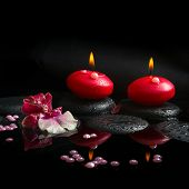 Spa Concept Of White And Red Orchid (cambria), Two Burning Candles And Pearl Beads On Zen Stones Wit