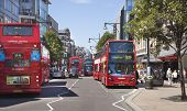 LONDON, UK - JUNE 3, 2014: Oxford street busy junction with lots of people and public transport