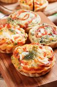 Mini quiche lorraine pie with vegetables and cream