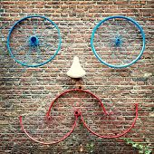 Old bike parts creating a face. Street scene, Amsterdam