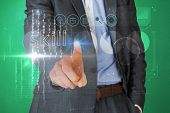 Businessman touching the word skill on interface against green vignette