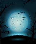 Creepy Halloween night with full moon for copy space