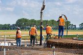 Workers Preparing A Concrete Foundation Of A Dutch Wind Turbine