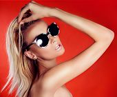 Attractive Blonde Beauty In Sunglasses.
