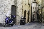 pic of vespa  - Italian motor scooter in typical italian village - JPG