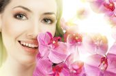stock photo of beautiful face  - beauty flower girl on the blurry background - JPG