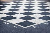 Chess Board On Asphalt