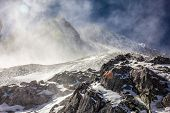 pic of jade  - The Snow blows over the top of the peak of the Jade Dragon Snow Mountain - JPG