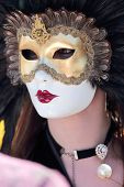 Masked Woman With Feathers At The Carnival Of Venice