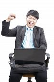 Young Business Man Working By Internet Online With Laptop Computer And Fists Up Acting Happy Face Is
