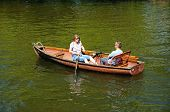 Couple in a rowing boat.