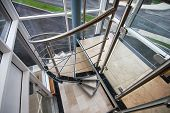 stock photo of staircases  - Stainless steel spiral staircase in modern office building - JPG