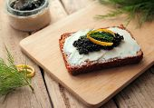Bread with caviar and cheese