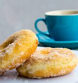 Coffe And Doughnuts Indicates Coffee Cup And Beverages