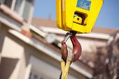 foto of crane hook  - Yellow Utility Indutrial Crane Head with Red Hook - JPG