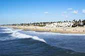 A panorama of the shoreline and sandy beach at historic Huntington Beach, California.