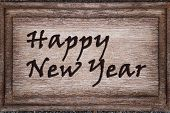 Happy New Year On Wooden Plaque