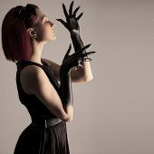 stock photo of gothic hair  - Beautiful elegant woman with red hair and black hands - JPG