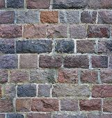 seamless stone wall from a granite brick