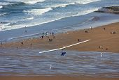 stock photo of glider  - hang glider flying above Woolacombe beach - JPG