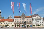 NOVI SAD, SERBIA - AUGUST 03: neo-classical architecture in Liberty Square of Novi Sad and flags of Serbia, Vojvodina and Novi Sad. Shot in 2014
