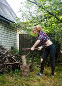 Serious Woman Chopping Wood