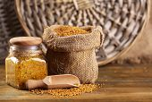 pic of mustard seeds  - Mustard seeds in bag and Dijon mustard in glass jar on wooden background - JPG